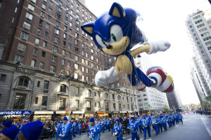 FILE - In this Nov. 22, 2012, file photo, handlers keep a tight rein on the Sonic the Hedgehog balloon as it travels the route of the Macy's Thanksgiving Day Parade in New York. Macy's says it is closely monitoring the weather after recent forecasts predicted wind gusts up to 30 mph on Thanksgiving morning during the department store's upcoming Thanksgiving Day Parade. Based on New York City guidelines, no giant balloons will be operated if the wind gusts exceed 34 mph. (AP Photo/Charles Sykes, File)